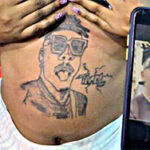 Reactions as pregnant lady tattoos Mayorkun's face on baby bump