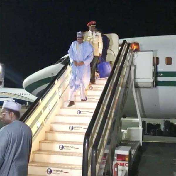 Buhari Out Of Aircraft