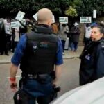 Mixed Reactions as #BuhariMustGo Protesters Meets Pro-Buhari Protesters in The UK (VIDEO)